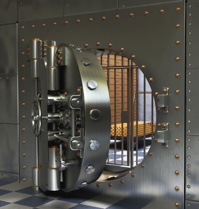 Opened Antique iron safe isolated on white background